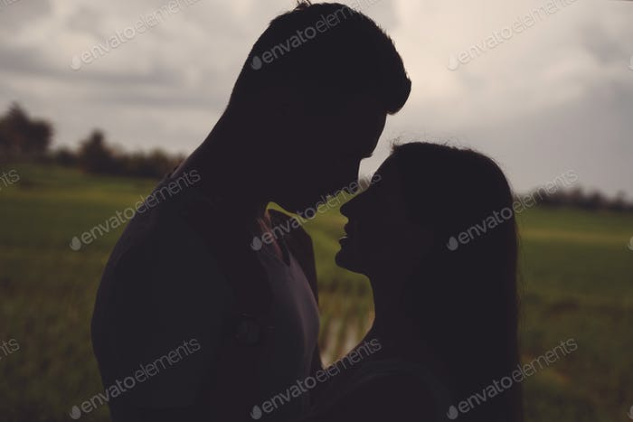 Silhouette of couple on sunset background