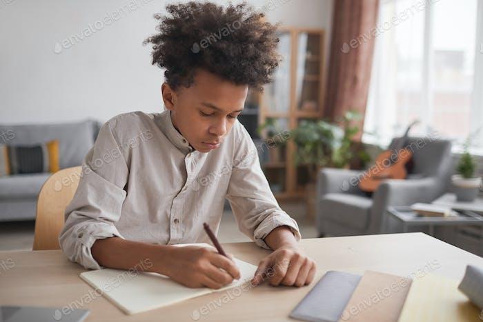 African-American Boy doing Homework at Desk