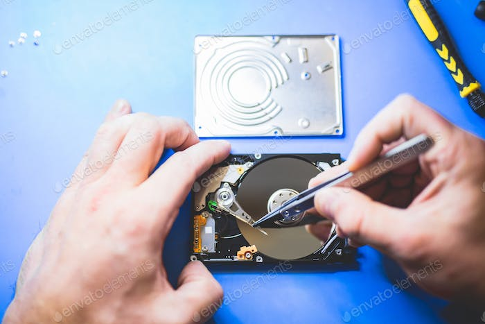 Man fixing a hard disc.