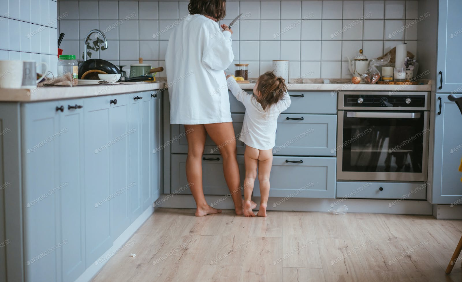 Mom and daughter preparing breakfast photo by simbiothy on Envato ...