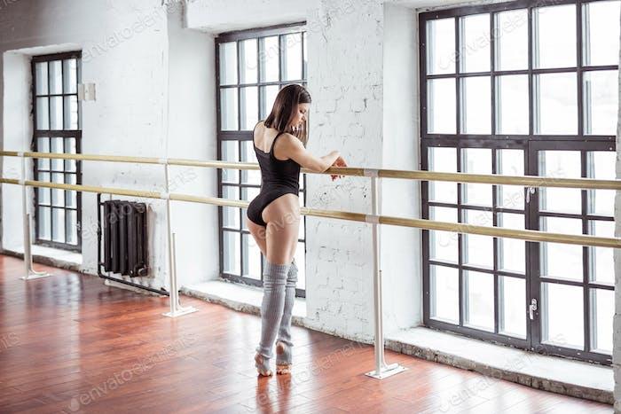 Young girl dancing indoors
