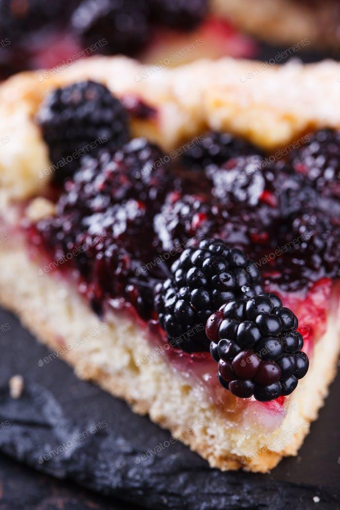 Sweet pastries with berries. Dessert.Galette with blackberries
