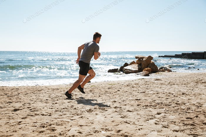 Healthy young sportsman jogging