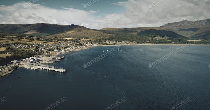 Scotland ocean port aerial view: ship, yachts and boats on coastal water of Atlantic gulf