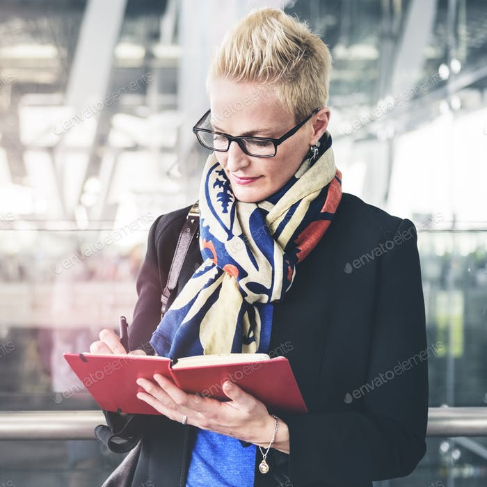 Businesswoman Writing Waiting Flight Concept