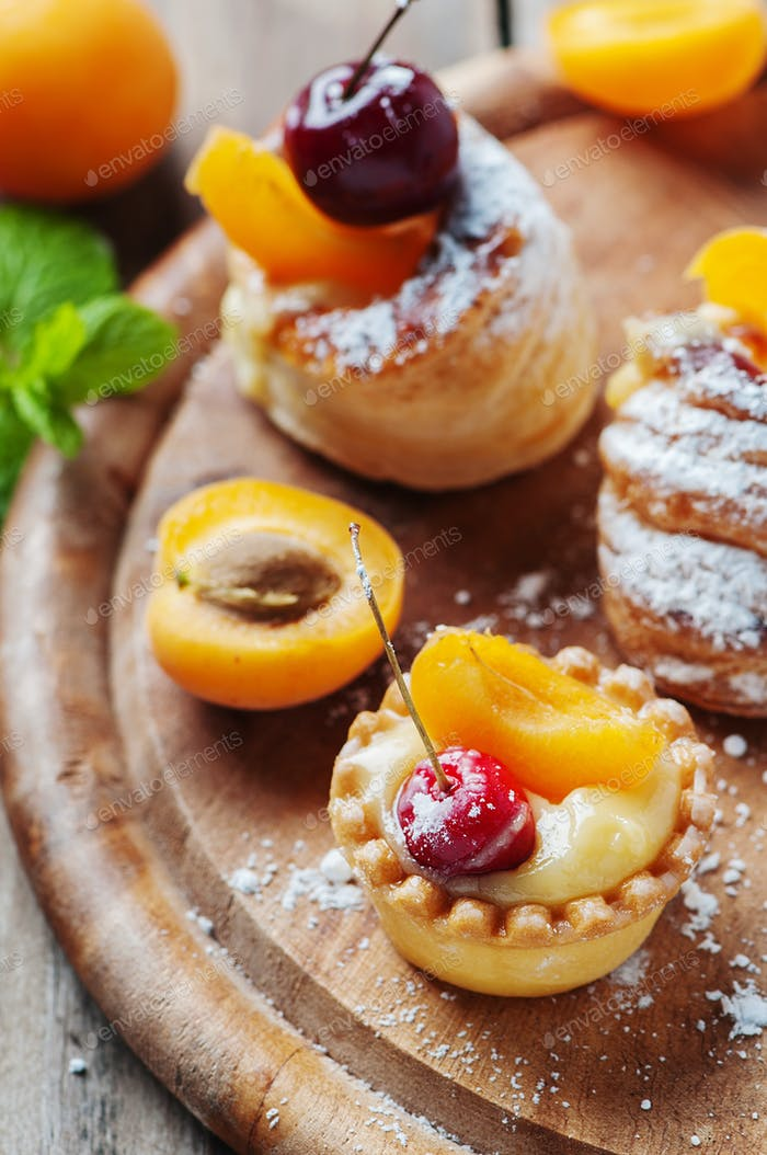 Sweet tarts with cherry and apricot