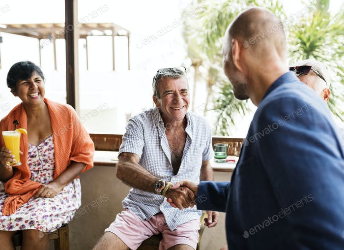Hotel manager shaking hands with a guest