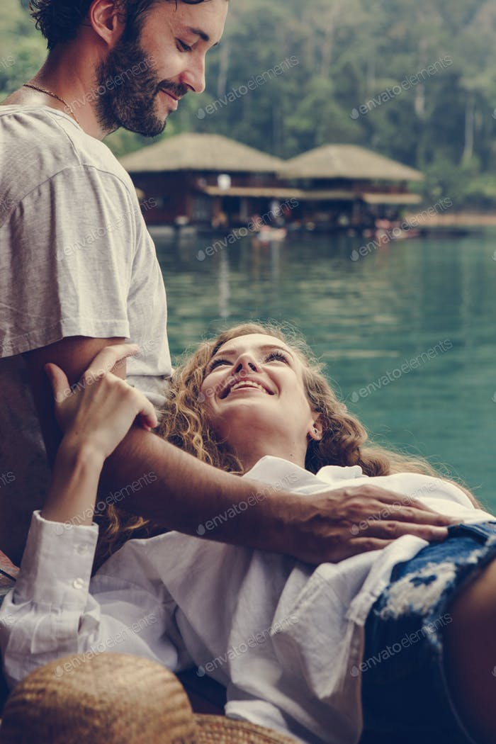 Woman relaxing in her boyfriends lap