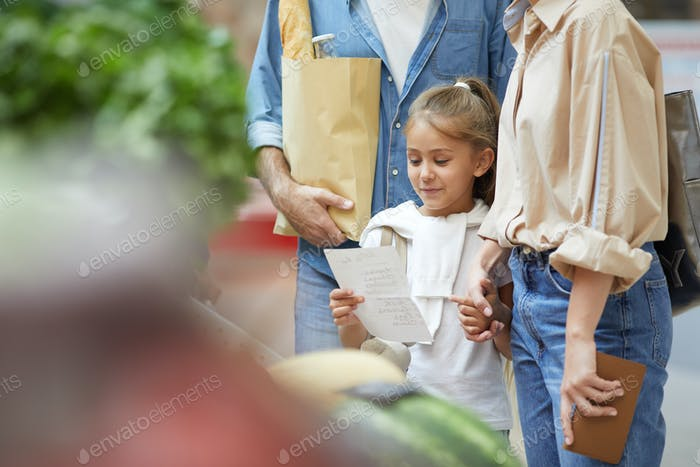 Little Girl Grocery Shopping with Family