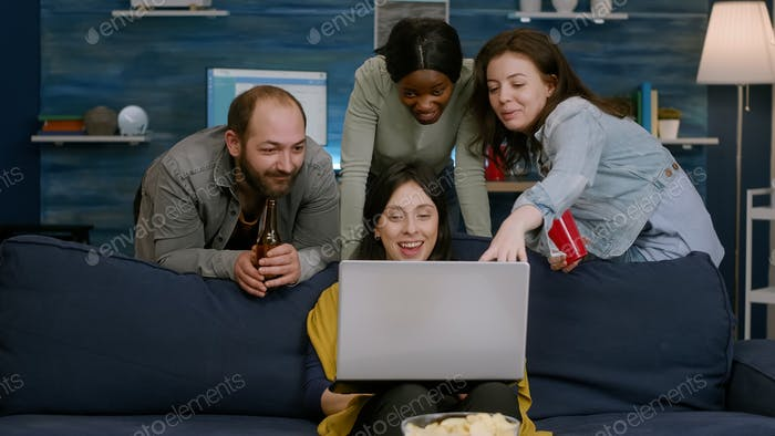 Group of mixed race people spending time together watching comedy movie