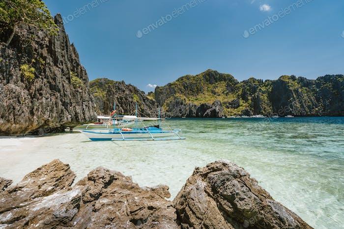 Tourism tour boat moored at the beach of Shimizu Island - El Nido, Palawan, Philippines