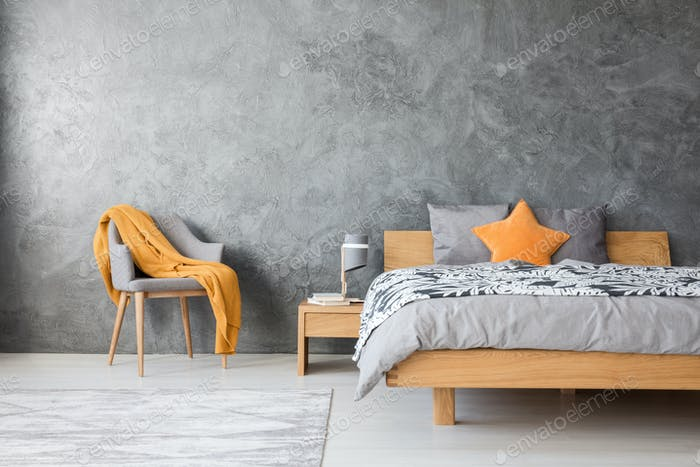 Grey bedroom with chair