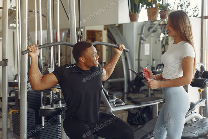 Handsome black man training with white coach