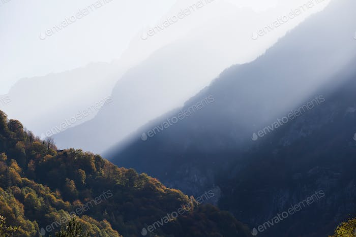 Dolomite mountains in morning mist.