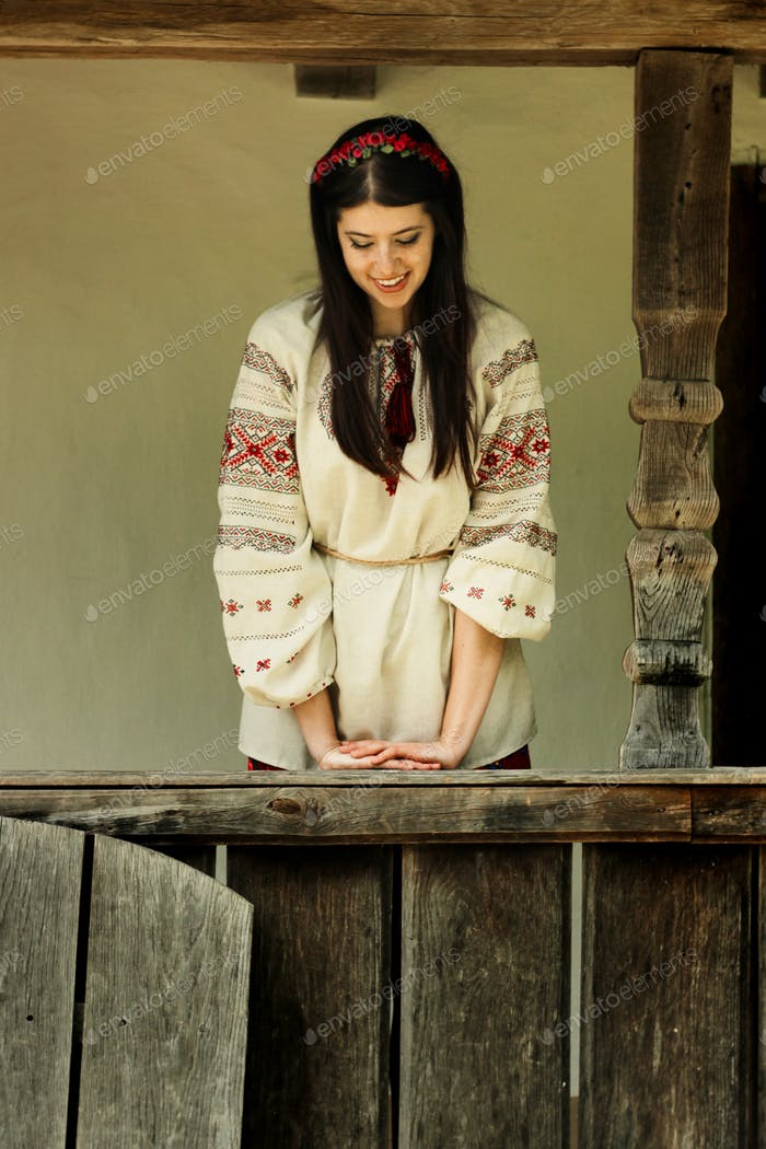 beautiful brunette woman in national ukrainian embroidery clothes