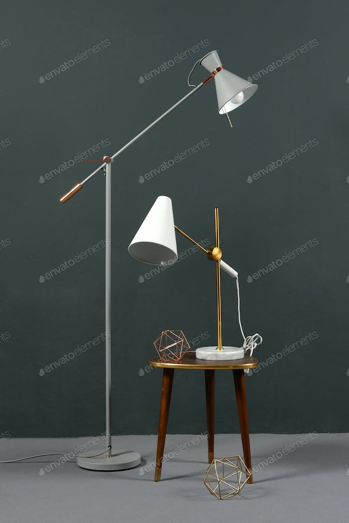 Two vintage anglepoise lamps in a grey interior