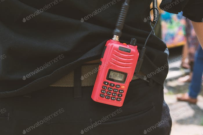 Red radio communication with security guard
