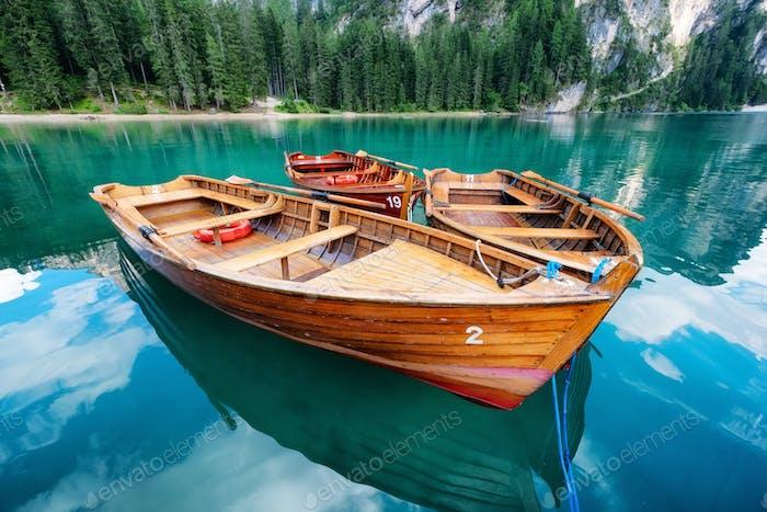 Lago di Braers lake, Dolomite Alps, Italy. Boats on the lake. Landscape in the Dolomite Alps, Italy.