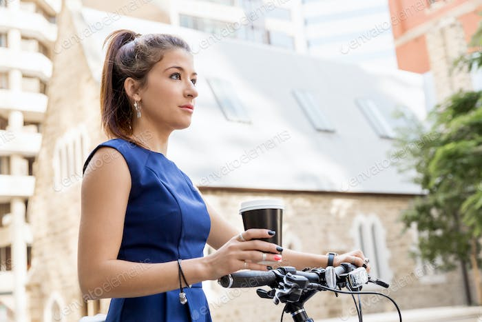 Young woman commuting on bicycle