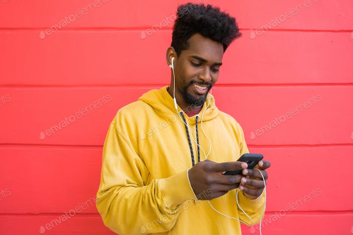 Afro man using his mobile phone.