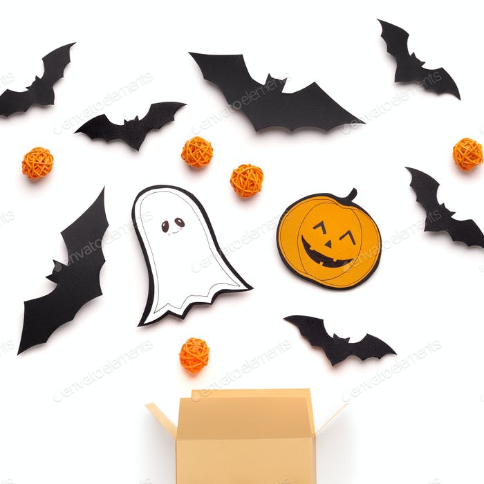 Close up of Halloween paper figures and treat or trick candies