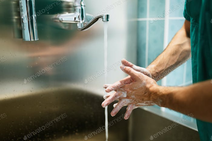 Surgeon washing hands to operation using correct technique for cleanliness