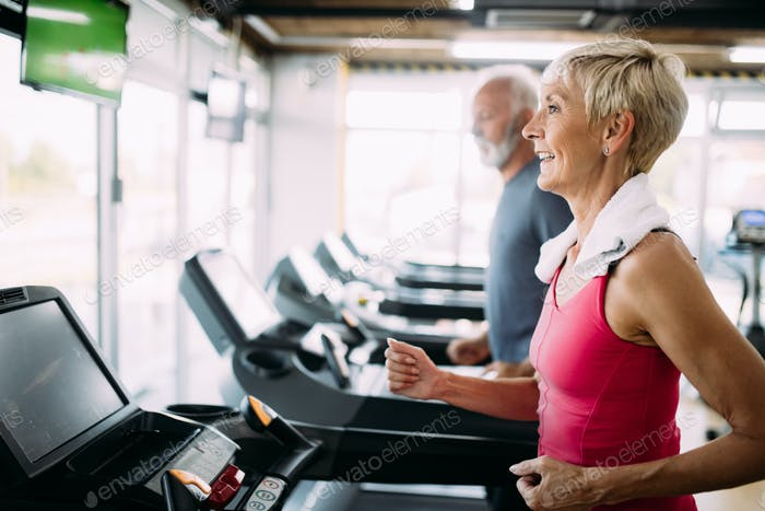 Image of attractive fit senior woman in gym