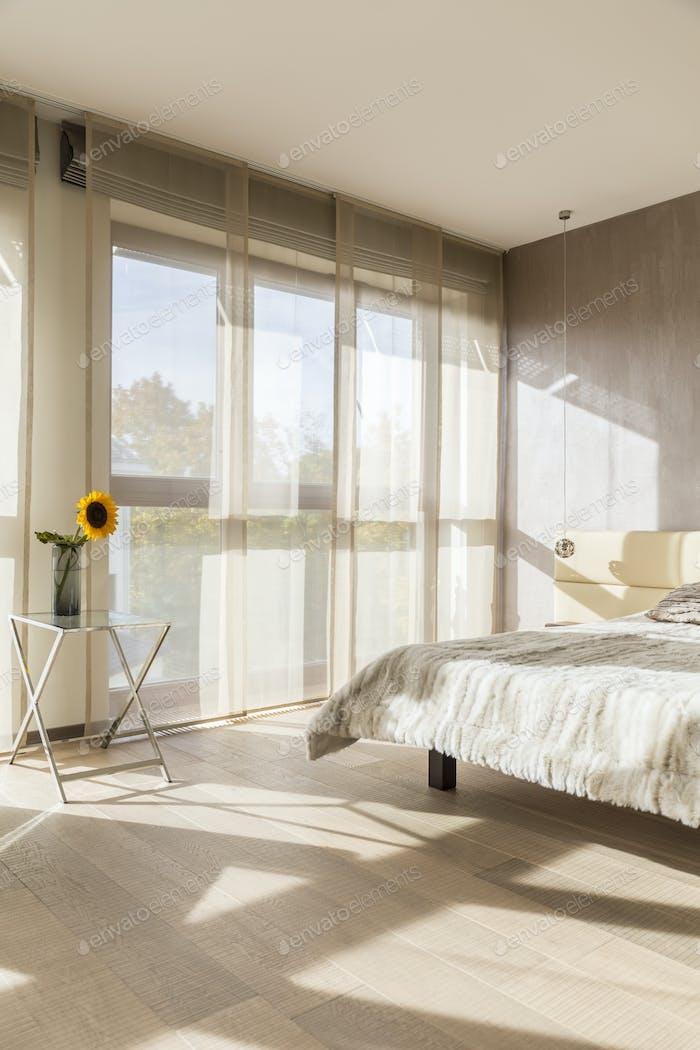 Beige bedroom with double bed