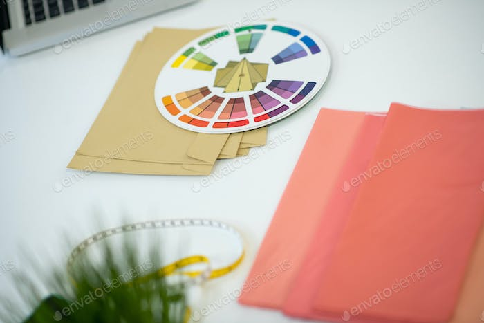 Top view of a colour palette lying on the table