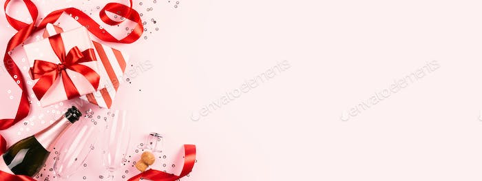 Gifts, Champagne and Two Glasses on Pink Background.