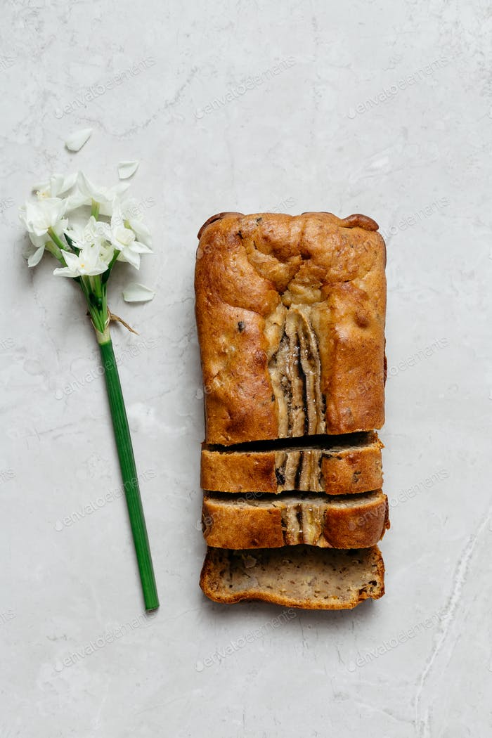 Sliced Banana Bread Loaf on Grey Marble Table