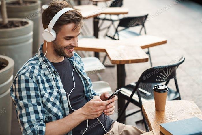 Smiling young man wearing headphones