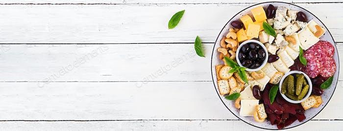 Antipasto platter with basturma, salami, blue cheese, nuts, pick