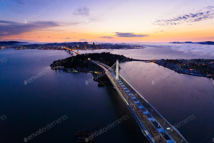 Aerial view of San Francisco Oakland Bay Bridge at sunset