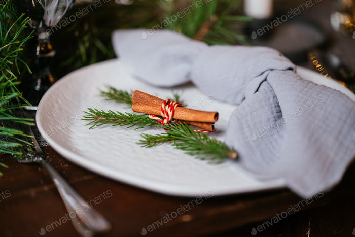 Beautifully decorated Christmas table in the living room. With the objects of holiday decor.