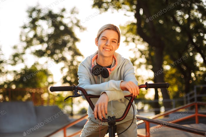 Beautiful smiling girl with headphones happily looking in camera