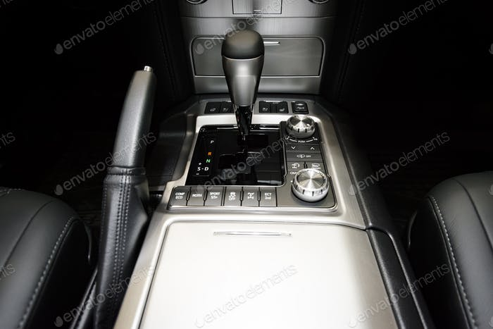 automatic transmission gear stick in modern car interior
