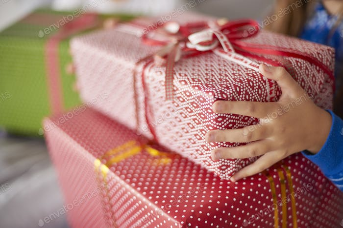 Close up of Christmas presents in child's hands