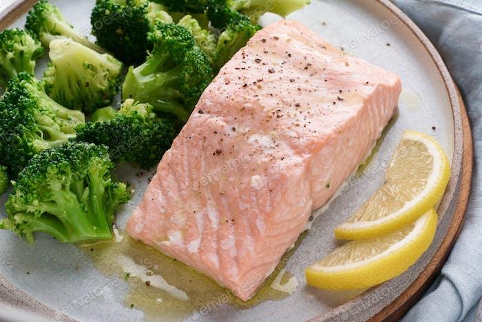 Steam salmon, broccoli, paleo, keto, lshf or dash diet. Mediterranean, Clean eating, balanced food.
