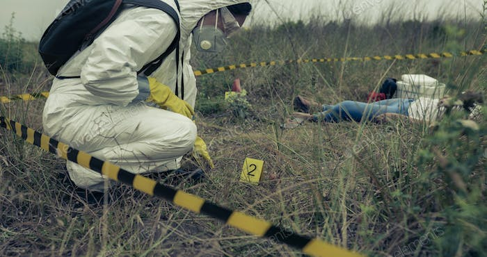 Woman with protection equipment examining evidence