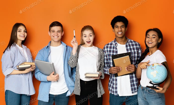 Teen friends with copybooks and earth globe