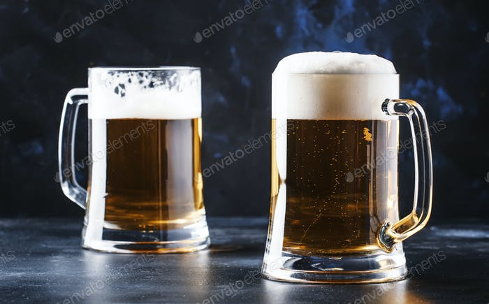 Glasses with czech light beer, dark bar counter