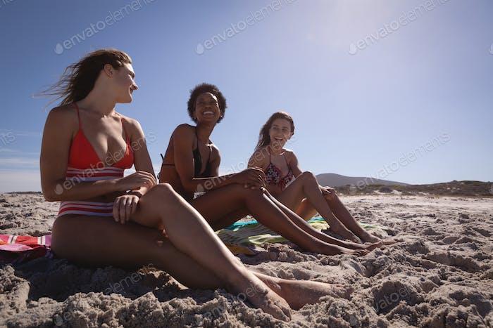 Beautiful young women relaxing and having fun on beach in the sunshine
