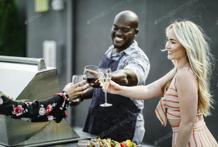 Gorgeous friends toasting at a summer party