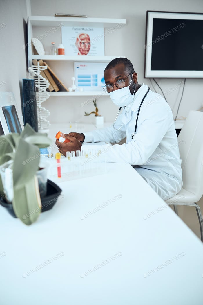 Troubled medical worker having doubts about choosing the medicine