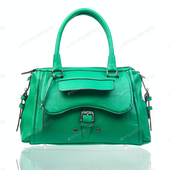 Green female handbag over white background