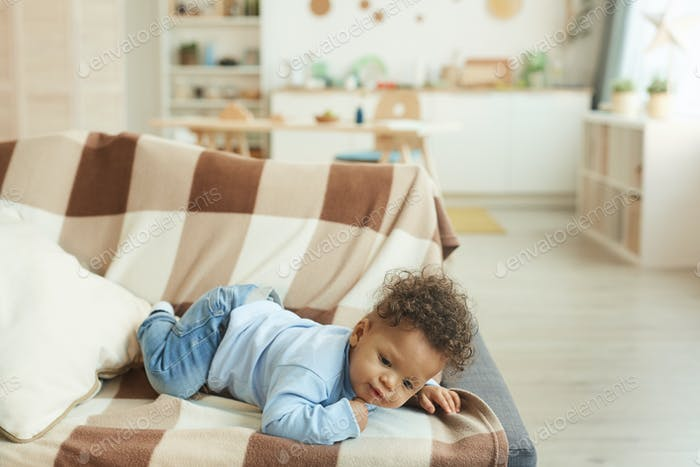 Cute Mixed-Race Baby in Home Interior