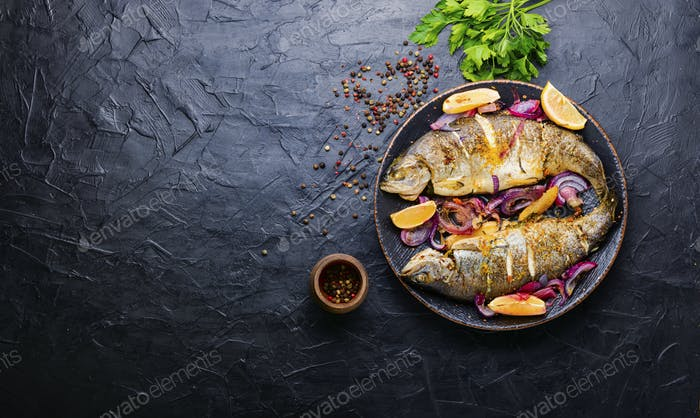 Two grilled trouts with lemon,fish dish