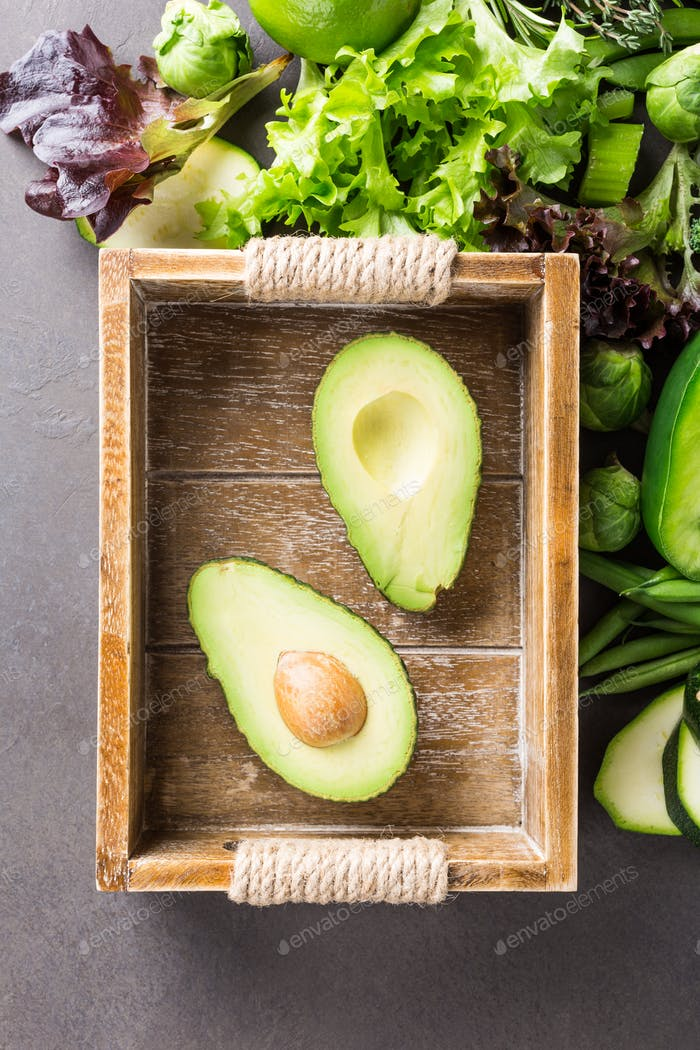Avocado in wooden tray