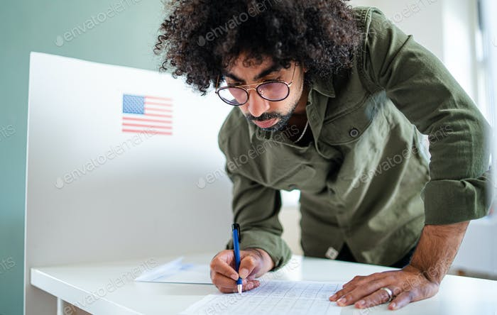 Man voter in polling place, usa elections concept